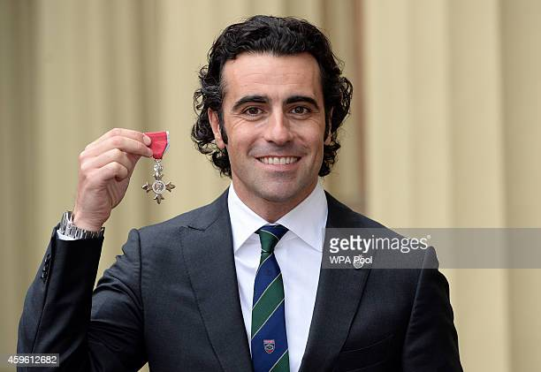 Racing driver Dario Franchitti holds his Member of the Order of the British Empire after the Investiture ceremony at Buckingham Palace on November 26...