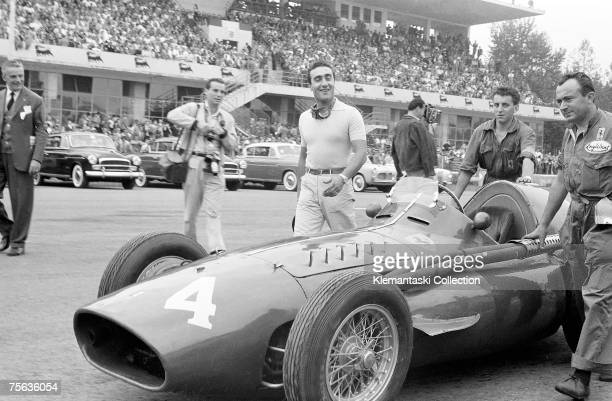 Racing driver Eugenio Castellotti with his Ferrari 'Squalo' walking to the grid before the start of the Italian Grand Prix at Monza 11th September...