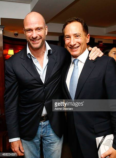 Racing driver Giuseppe Cipriani and CEO of Griffon Corp Ron Kramer attend as IWC CEO Georges Kern celebrates with DuJour's Jason Binn for a preArt...