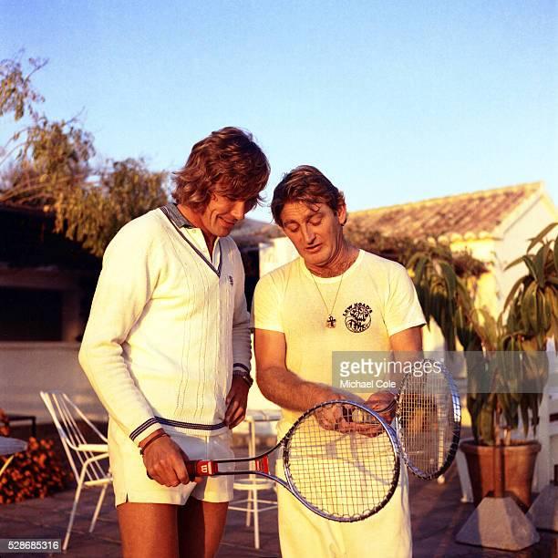 Racing Driver James Hunt & Lew Hoad at Lew Hoad's 'Campo De Tenis' in Mijas, Spain December 1974