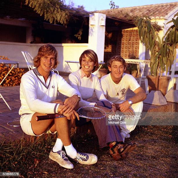 Racing Driver James Hunt & wife Suzy with Lew Hoad at Lew Hoad's 'Campo De Tenis' in Mijas, Spain December 1974