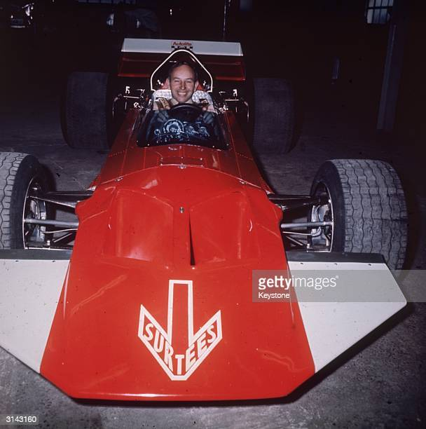 Racing driver John Surtees in a bright red Surtees TS7 Formula 1 racing car He was world champion in 1964
