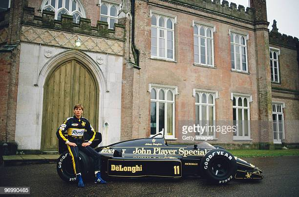 Racing driver Johnny Bute ,Marquess of Bute aka Johnny Crichton-Stuart and Johnny Dumfries drives poses with the John Player Special Lotus-Renault...