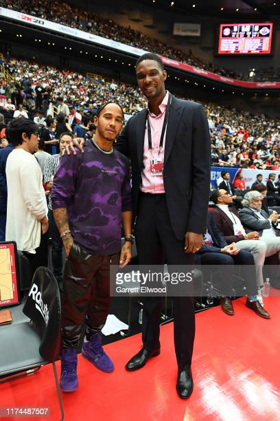 Racing Driver Lewis Hamilton poses for a photo with Retired NBA Player Chris Bosh during the 2019 NBA Japan Game between the Toronto Raptors and the...