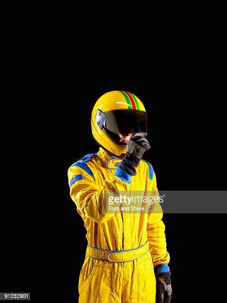 Racing driver looking though visor on black