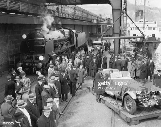 Racing driver Lord Howe driving his Mercedes sports car onto the float at Dover ready to be hoisted on board the Southern Railway's crosschannel...