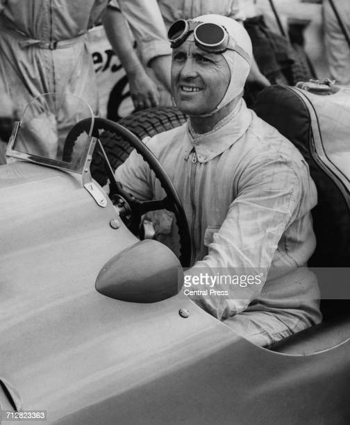 Racing driver Louis Chiron of Monaco sits aboard the Ecurie France TalbotLago T26C before the start of the RAC International Grand Prix on 2 October...