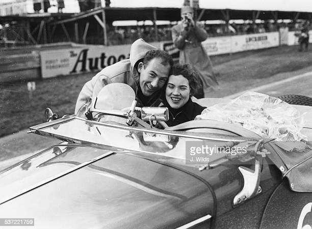 Racing driver Stirling Moss congratulating his sister Pat Moss as she wins the Ladies Handicap at the Goodwood Circuit England 1955