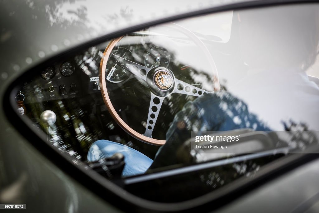 A racing driver waits in his car ahead of a race during the Goodwood Festival Of Speed at Goodwood on July 13, 2018 in Chichester, England.