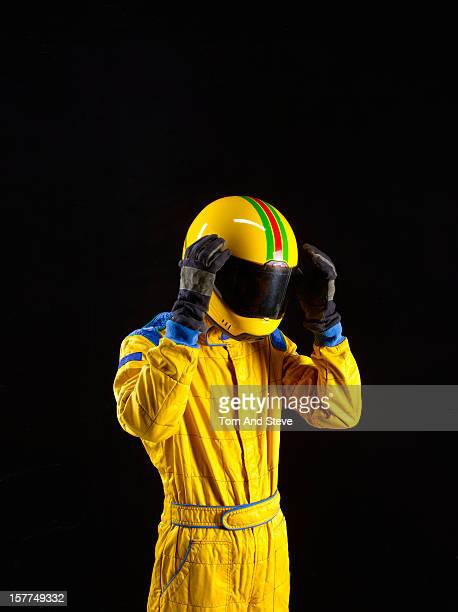 Racing driver with hands to head in disappointment