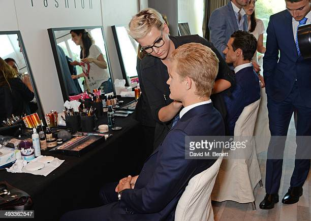 Racing drivers Marcus Ericsson and Adrian Sutil attend the Amber Lounge 2014 Gala at Le Meridien Beach Plaza Hotel on May 23 2014 in Monaco Monaco