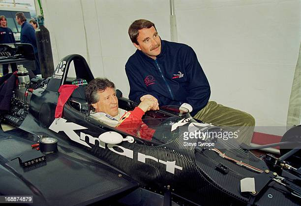 Racing drivers Mario Andretti and Nigel Mansell during testing of the Lola T93/00 Newman Hass Indy car at Phoenix International Raceway Phoenix...