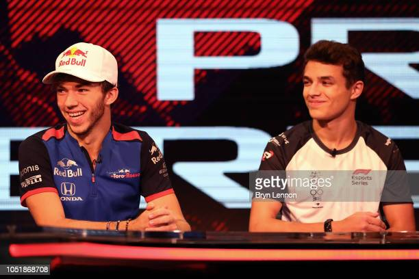 Racing drivers Pierre Gasly of France and Scuderia Toro Rosso and Lando Norris attend the GFinity Arena on October 10 2018 in Fulham England