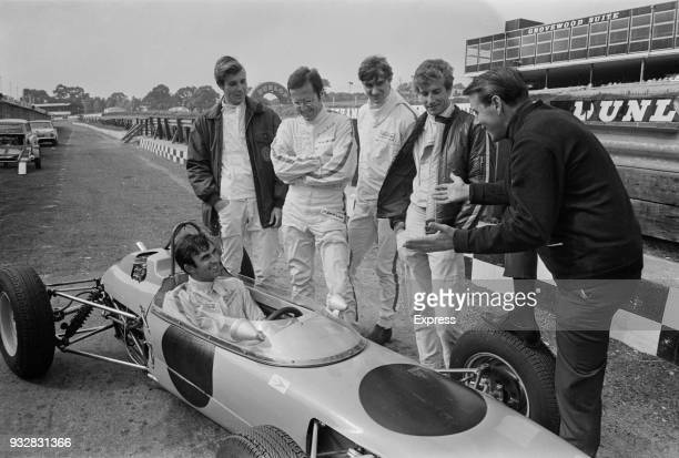 Racing drivers Ray Allen Brian Smith Dave Morgan Tony Trimmer chat with Australian racing driver Tim Schenken and Chris Steele at Brands Hatch UK...