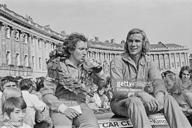 Racing drivers Robert Fearnall and James Hunt celebrating with a Coca-Cola in the Royal Crescent in Bath, after winning the 1973 Avon Motor Tour of...