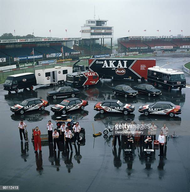 Racing drivers Stirling Moss and Richard Lloyd with the rest of the AKAI Audi team 12th October 1980
