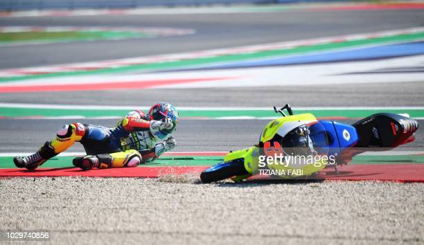 Racing Factory 3570 MTA's rider Italian Kevin Zannoni falls during the Moto3 race of the San Marino Grand Prix at the Marco Simoncelli Circuit in...