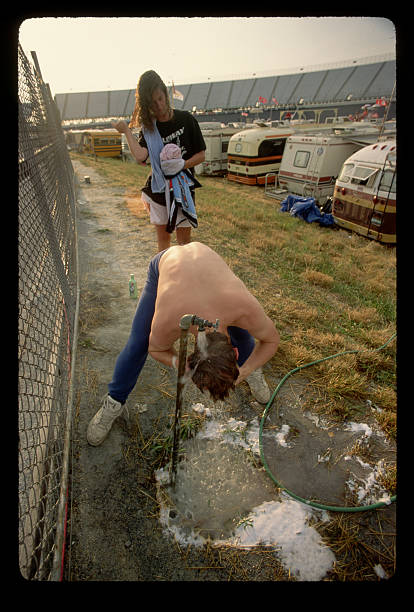 Racing Fan Washing His Hair After Camping