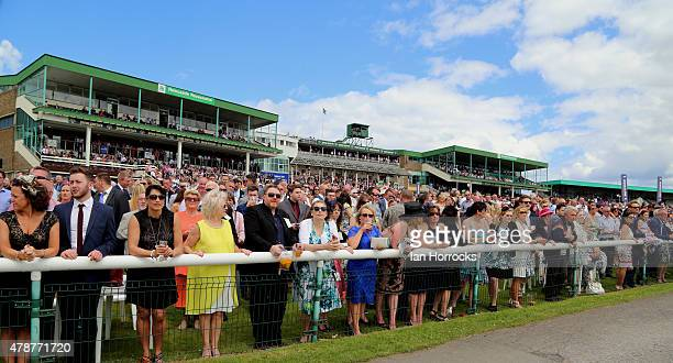 Racing fans line the track fence ahead of The Northumberland Plate during The Northumberland Plate Meeting at High Gosforth Park on June 27 2015 in...