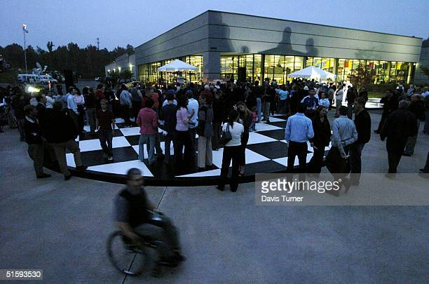 NASCAR racing fans pay their respects before the beginning of a candlelight vigil at Hendrick Motor Sports October 27 in Charlotte North Carolina...