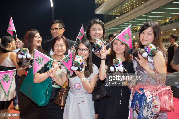 Racing fans supporting the Hong Kong runner Aerovelocity at Kranji Racecourse during the Singapore International Racing Festival on May 17 2015 in...