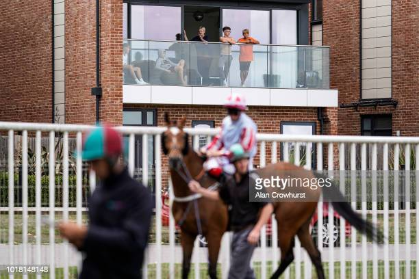 Racing fans watch from one of the new flats built on the course at Newbury Racecourse on August 17 2018 in Newbury United Kingdom