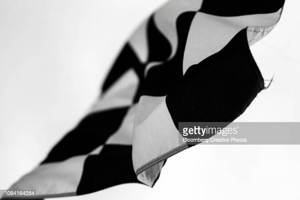a racing flag flies at finish line - 決勝線 ストックフォトと画像