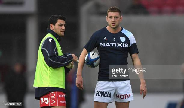 Racing fly half Finn Russell chats to Sam Hidalgo Clyne of the Scarlets before the Champions Cup match between Scarlets and Racing 92 at Parc y...