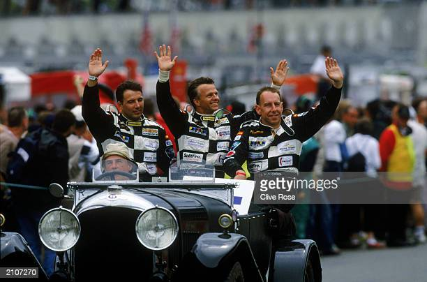 Racing for Holland Dome driven by John Bosch of Holland Jan Lammers of Holland and Andy Wallace of Great Britain wave to the crowd during the Le Mans...