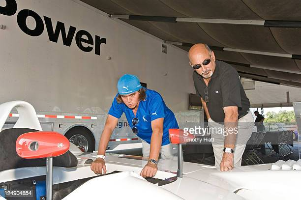 Racing legend Bobby Rahal and PGA TOUR player Rickie Fowler look over a BMW American Le Mans Series prototype racer at the kickoff to the BMW...