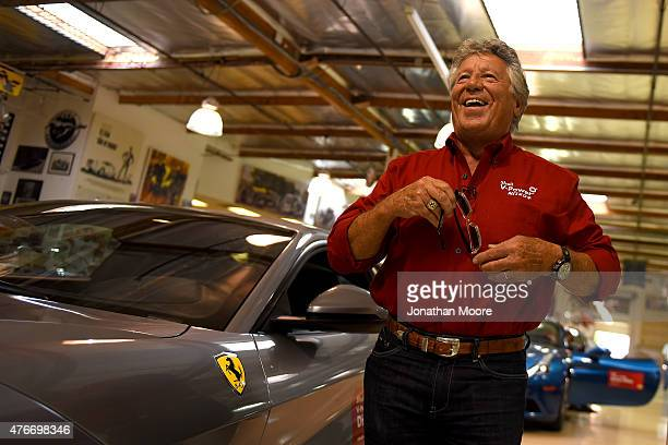 Racing legend Mario Andretti arrives to the final stop of the Shell Cross-Country Relay at Jay Leno's Garage in a Ferrari California T on June 9 to...