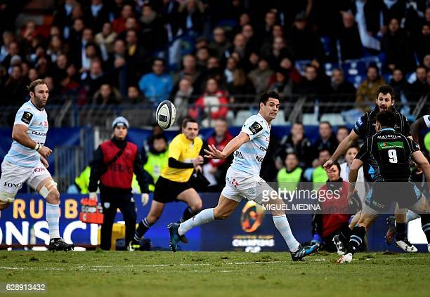 Racing Metro 92 New Zealand flyhalf Dan Carter passes the ball during the European Rugby Champions Cup rugby union match between Racing Metro 92 and...
