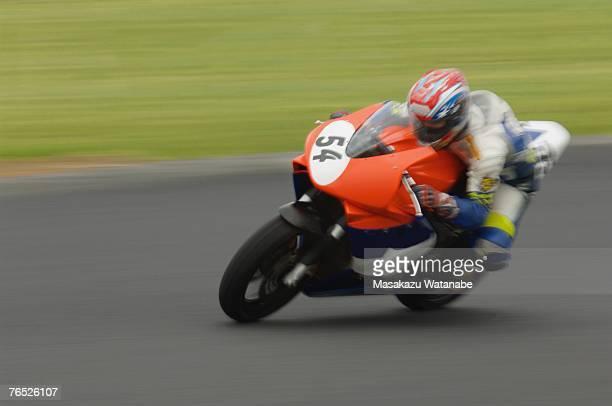 Racing motor bike heading into a corner