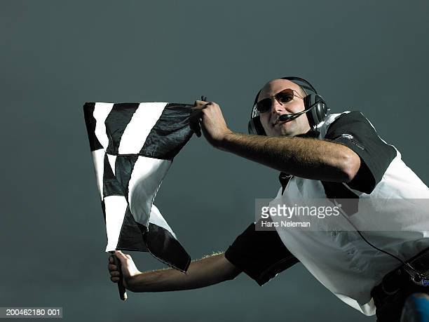 Racing official waving checkered flag
