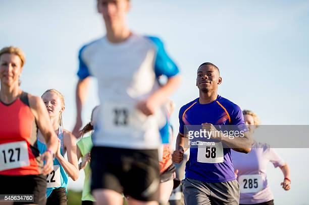 racing on a sunny day - 5000 meter stock pictures, royalty-free photos & images