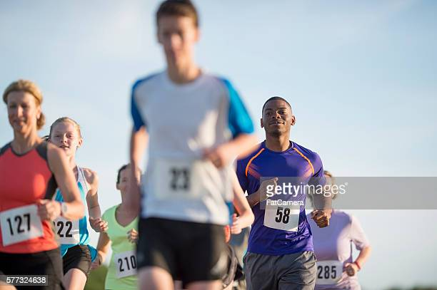 racing outdoors - 5000 meter stock pictures, royalty-free photos & images