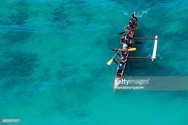 racing outrigger canoe - sports team event stock photos and pictures