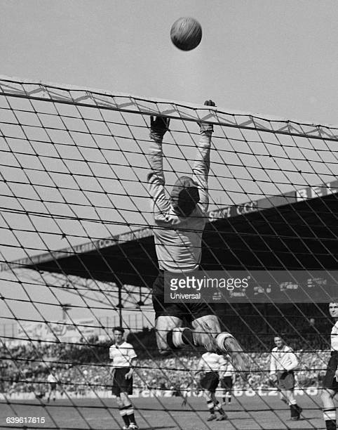 Racing Paris goalkeeper Rene Vignal attemps a save during a French championship match against Lille