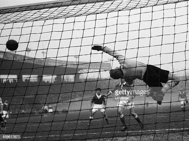 Racing Paris' goalkeeper Rene Vignal attempts a spectacular save during a French Championship match against SaintEtienne