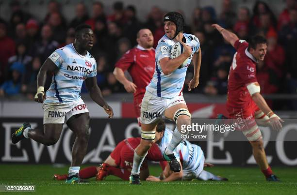 Racing player Baptiste Chouzenoux races away to score the first try during the Champions Cup match between Scarlets and Racing 92 at Parc y Scarlets...