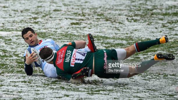 Racing player Brice Dulin is tackled by Nick Malouf of the Tigers during the European Rugby Champions Cup match between Leicester Tigers and Racing...