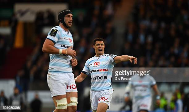 Racing player Dan Carter directs play as Luke Charteris looks on during the European Rugby Champions Cup match between Racing Metro 92 and...