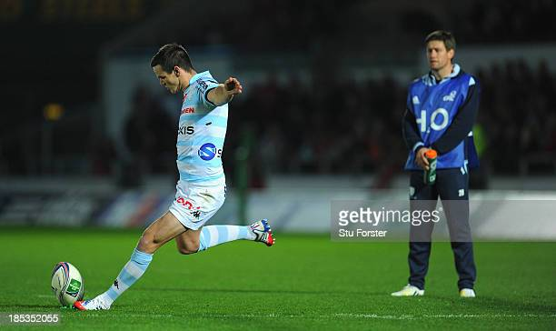 Racing player Jonathan Sexton kicks at goal watched by Ronan O'Gara during the Heineken Cup Pool 4 mach between Scarlets and Racing Metro 92 at Parc...