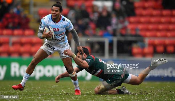 Racing player Teddy Thomas breaks the tackle of Gareth Owen of Tigers during the European Rugby Champions Cup match between Leicester Tigers and...