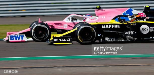 Racing Point's Canadian driver Lance Stroll and Renault's French driver Esteban Ocon race during the Formula One British Grand Prix at the...