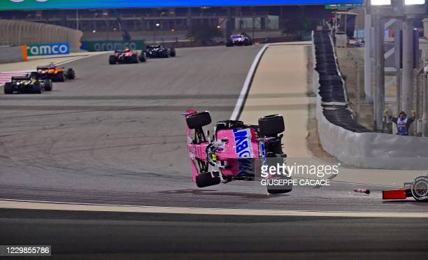 Racing Point's Canadian driver Lance Stroll crashes during the Bahrain Formula One Grand Prix at the Bahrain International Circuit in the city of...