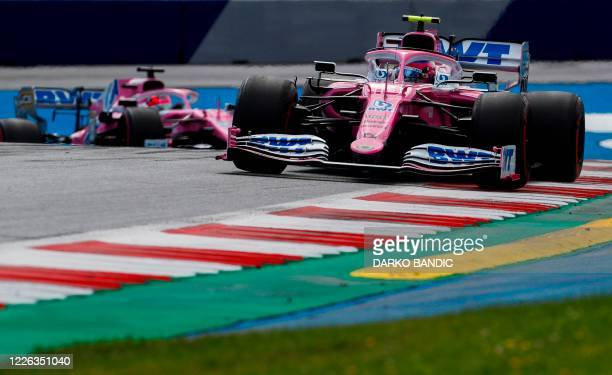Racing Point's Canadian driver Lance Stroll steers his car ahead of Racing Point's Mexican driver Sergio Perez during the Formula One Styrian Grand...