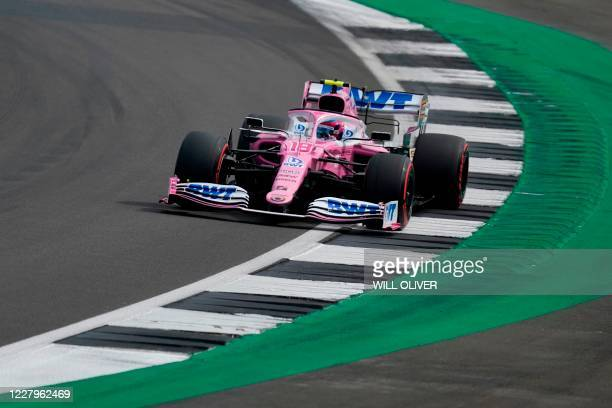 Racing Point's Canadian driver Lance Stroll steers his car during the qualifying session of the F1 70th Anniversary Grand Prix at Silverstone on...