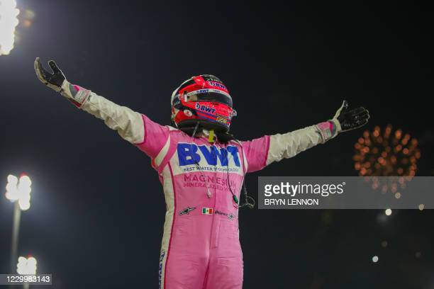 Racing Point's Mexican driver Sergio Perez celebrates winning the Sakhir Formula One Grand Prix at the Bahrain International Circuit in the city of...
