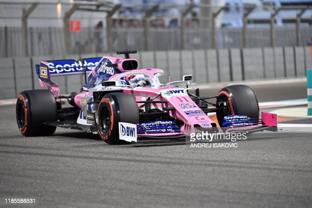 Racing Point's Mexican driver Sergio Perez steers his car during the qualifying session at the Yas Marina Circuit in Abu Dhabi, a day ahead of the...